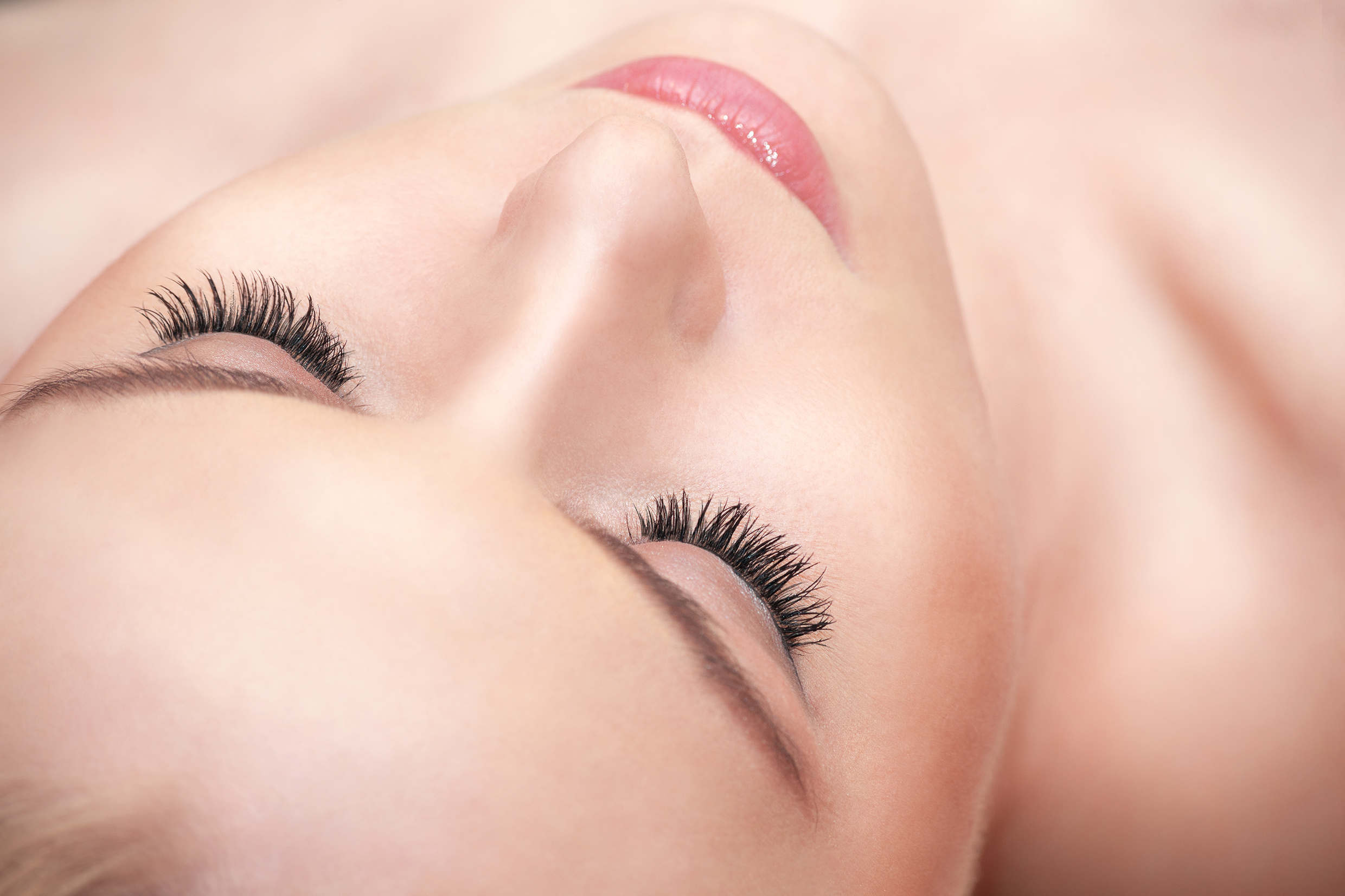 Lying attractive woman eyes with long eyelashes.